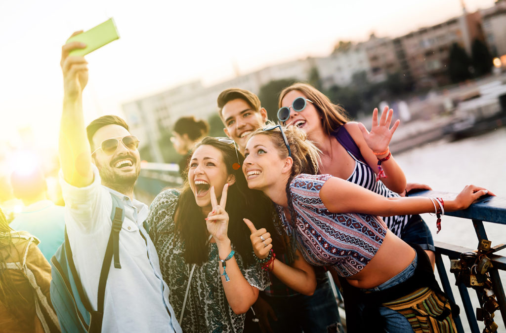 Marketing to Generation Z. Teens look up at a phone taking a selfie
