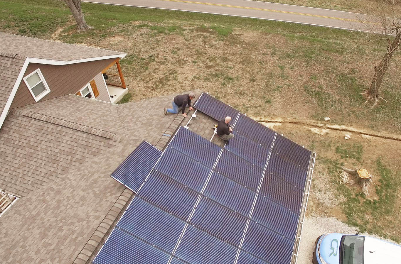 photo of a carbon recall employee installing solar panels on a residential home